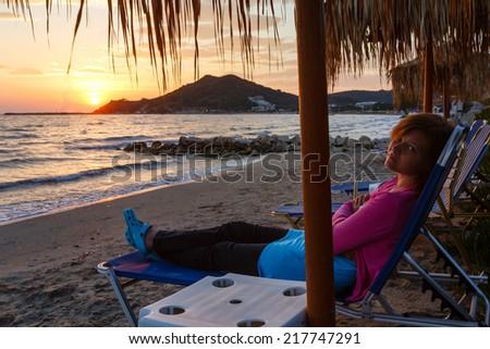 Sunrise view from beach. Summer coastline (Greece, Zakynthos, Alykes, Ionian See). - stock photo