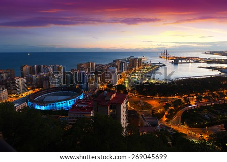 Sunrise view of Malaga with Port and Placa de Torros.   Spain