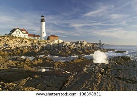 Sunrise view of Portland Head Lighthouse, Cape Elizabeth, Maine - stock photo