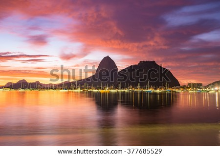 Sunrise view of Rio de Janeiro with mountain Sugar Loaf  - stock photo