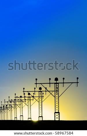 sunrise view on runway lights - stock photo