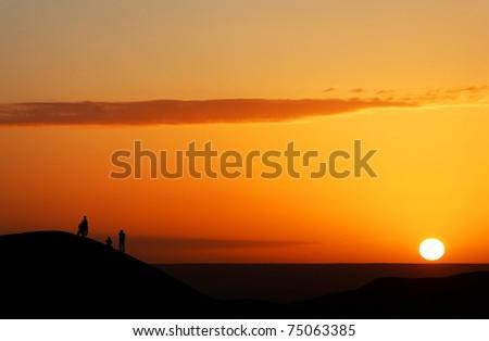 Sunrise watching in Sahara Desert, Africa - stock photo