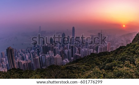 Sunrise with beautiful colors on a misty foggy morning over the city skyline hongkong by Victoria Peak Hong Kong February 2017