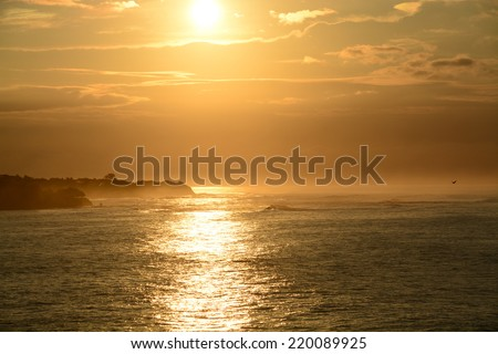 Sunrise with bright and vivid colors at a beach in Pedasi, Panama - stock photo