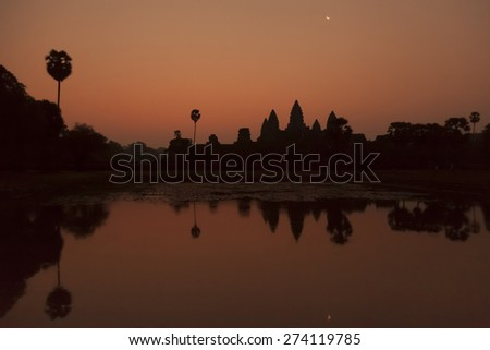 Sunrise with moon  at the famous temple of Angkor Wat near Siem Reap in Cambodia