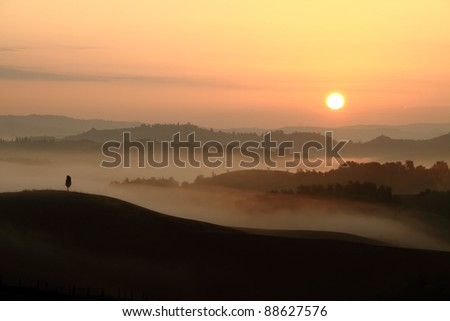 sunrise with tuscan hills and morning fog, Italy, Europe - stock photo