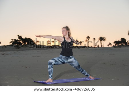 Sunrise Yoga session in Warrior pose.