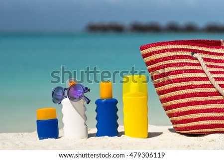 Sunscreen cream bottle on the beach