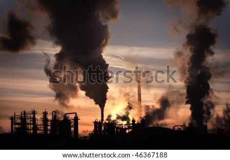 Sunset above factory - stock photo
