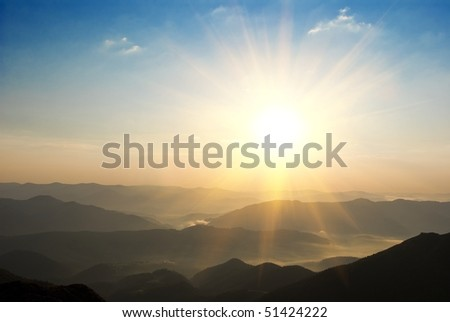 sunset above mountains - stock photo