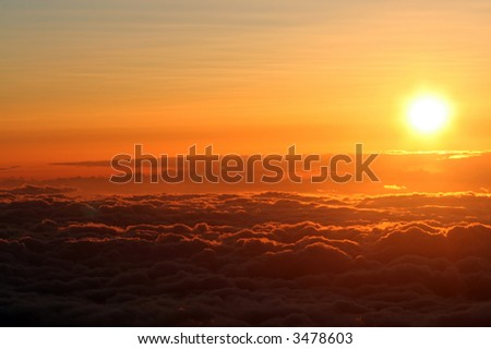 Sunset above the clouds at 14,000 ft on Mauna Kea, Hawaii - stock photo