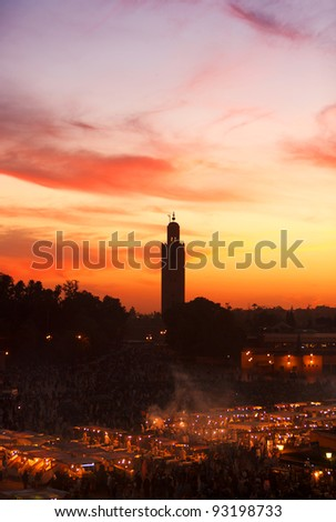 Sunset above the Jema el Fna Square and Koutoubia Mosque in Marrakesh, Morocco - stock photo