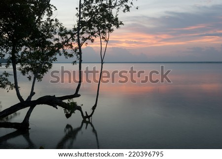 Sunset above water - stock photo
