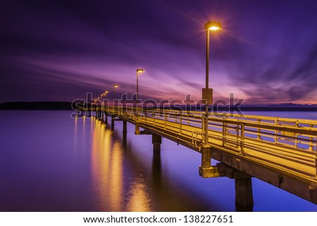 Sunset abstract photo at the dock and water - stock photo