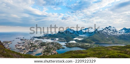 Sunset aerial panoramic view on stunning mountains and Svolvaer in Lofoten islands, Norway from Floeya top - stock photo