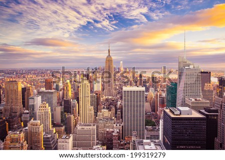 Sunset aerial view of New York City looking over midtown Manhattan towards downtown. - stock photo