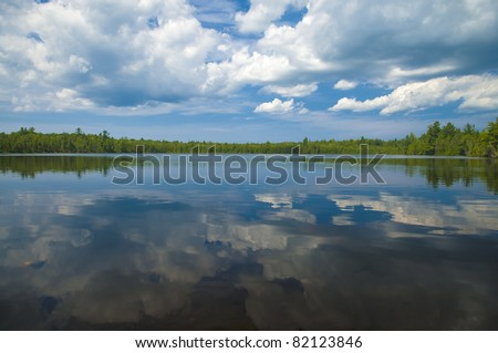 Sunset after Rainstorm reflection in the lake - stock photo