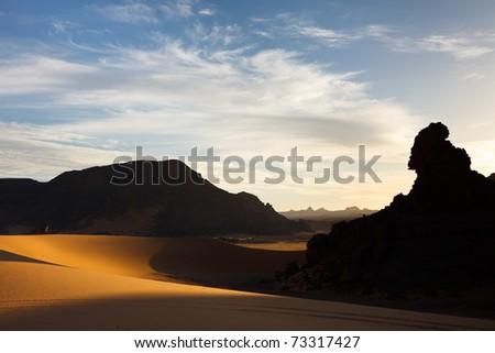 Sunset - Akakus (Acacus) Mountains, Sahara, Libya - Bizarre sandstone rock formations - stock photo