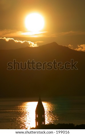 Sunset and a church - stock photo