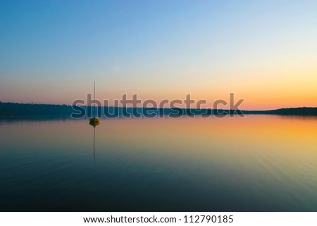 Sunset and boat in Cyprus lake, Tobermory, Ontario, Canada - stock photo