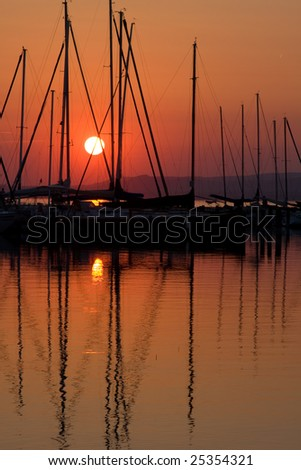 Sunset and boat with people 6. - stock photo