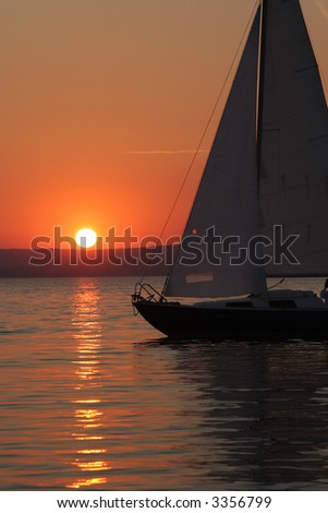 Sunset and boat with people 3. - stock photo