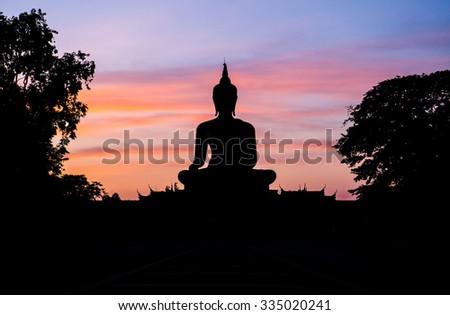 Sunset and Buddha - stock photo
