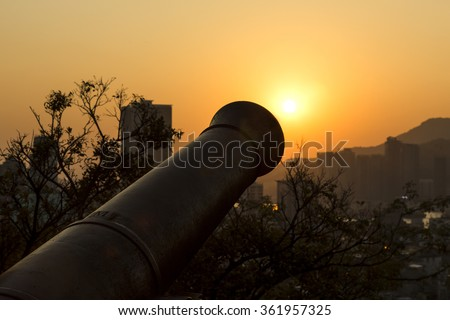 Sunset and Canon at Fortaleza do Monte in Macau, China. - stock photo