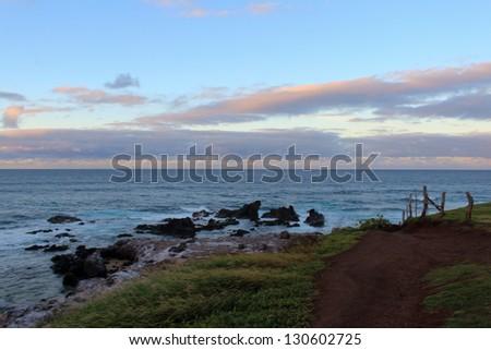 Sunset and Clouds Over Maui Coast at Ho'okipa - stock photo
