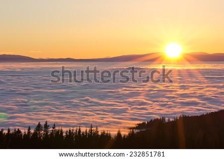 sunset and fog - stock photo