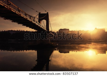 sunset and footbridge in Lyon city in France - stock photo