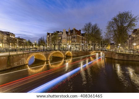 Sunset and night  at the intersection of Leidsegracht and Princengracht in Amsterdam  - stock photo