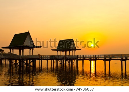 Sunset and pavilion, Phichit Province in Thailand. - stock photo