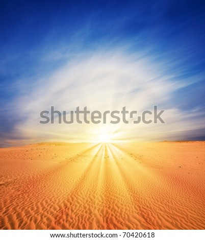 sunset and  rainbow in a sand desert - stock photo