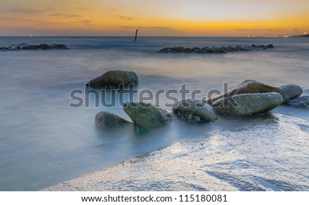 sunset and Rock with hin khow beach,rayong in thailand