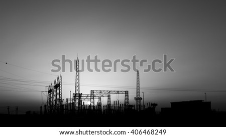 Sunset and silhouette of electrical sub station - Black and white