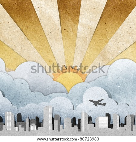sunset and sunrise city panorama silhouettes recycled paper craft stick on grunge paper background