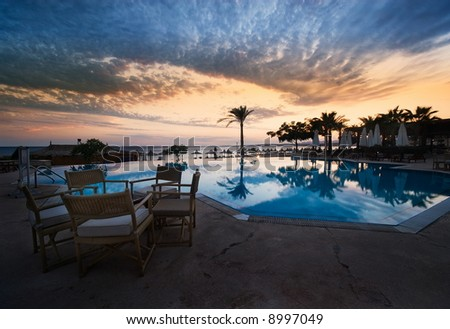 sunset and swimming pool at sharm el sheikh, egypt - stock photo