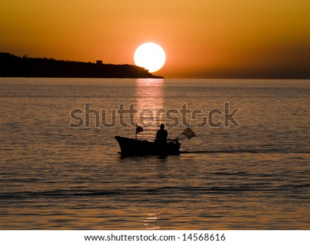Sunset and the fishing boat scene from Slovenia