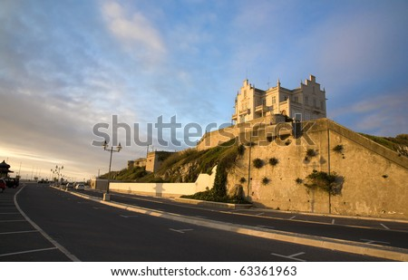 """Sunset and the golden hour view of the old marble cottage """"Palacete Almeida Araujo"""" a classic landmark in the Lagoa de Obidos lagoon beach, at Foz do Arelho, Silver Coast, Portugal - stock photo"""