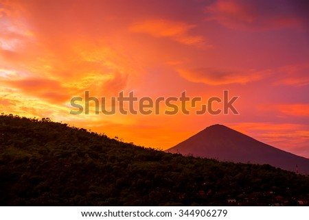 Sunset and Volcano - stock photo