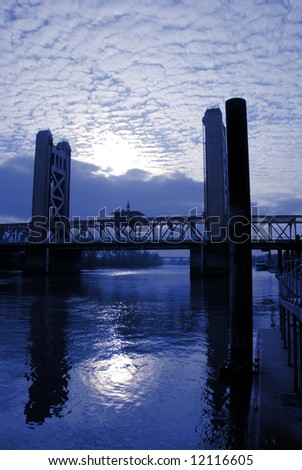 Sunset and Weathered Sky over Tower Bridge In Sacramento California - stock photo