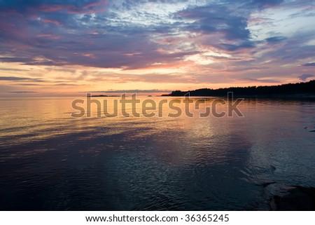 Sunset and white night at Kiy island, Russia - stock photo