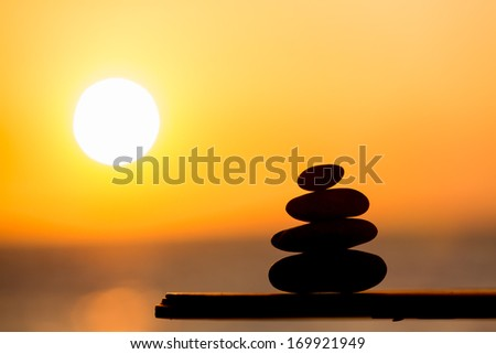 Sunset and zen stones - stock photo