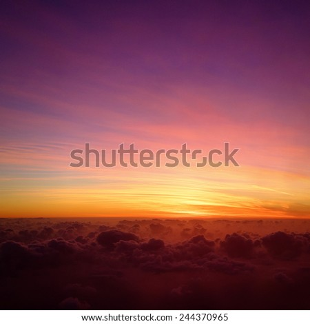 Sunset as seen from the plane - stock photo