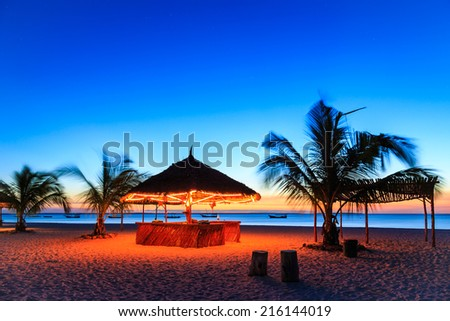 Sunset at a bar in a tropical resort - stock photo