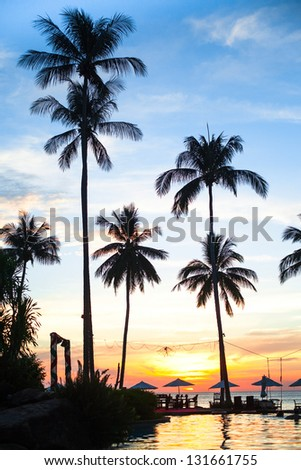 Sunset at a beach resort in the tropics. - stock photo