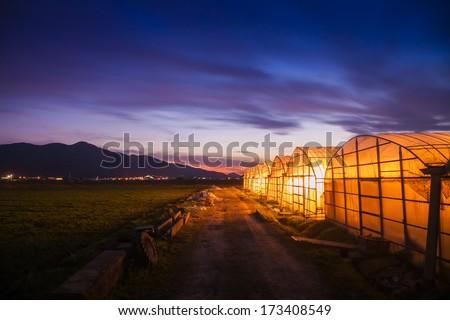Sunset at a farm - stock photo