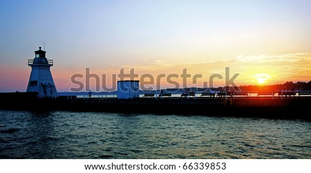 Sunset at a marina - stock photo