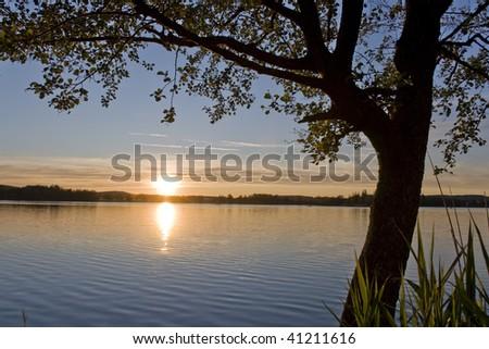 Sunset at a small lake near Lake Constance - stock photo